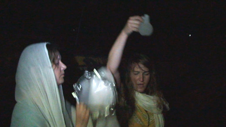 playing tambourine and with water from Ganges